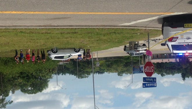 An FHP trooper gathers information at the scene of a fatal bicycle-car collision on Thursday.