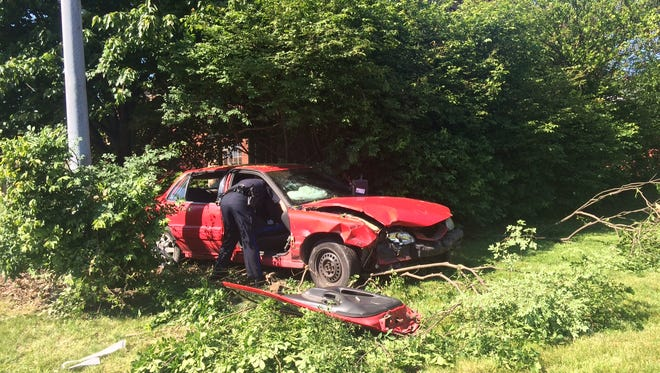 One woman was transported to Genesis Hospital after she hit a light pole with her car Thursday on Maple Avenue and crashed into foliage.