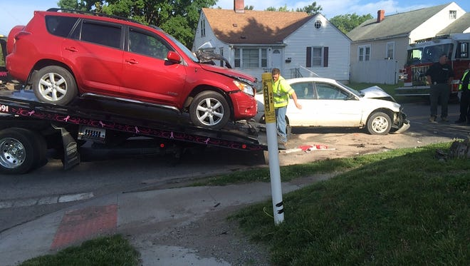Two people were transported to Genesis Hospital on Friday after a two-car crash at the intersection of Pine Street and Echo Avenue.