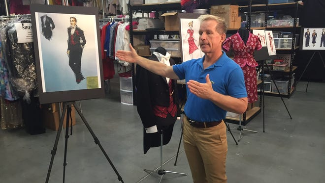 Norwegian Cruise Line Holdings vice president of entertainment Richard Ambrose shows off costume designs for an upcoming show on Regent Seven Seas Cruises' Seven Seas Explorer.