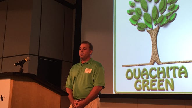 Ouachita Green Coordinator Stuart Hodnett discusses upcoming projects during a luncheon in Monroe Friday.