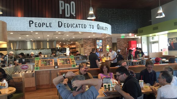 A crowd enjoys lunch at PDQ during the soft launch.