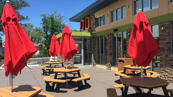 Outdoor seating along Haddonfield Road in Cherry Hill for PDQ customers.