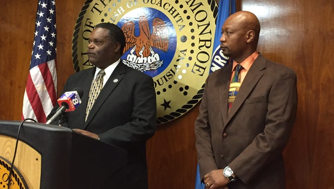 Monroe Mayor Jamie Mayo (left) and Monroe Transit General Manager Marc Keenan announce funding for additional buses Monday.