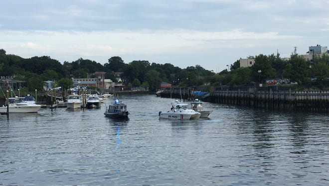 Marine units from multiple police agencies respond to a report of a body in the Byram River near the Port Chester-Greenwich border.