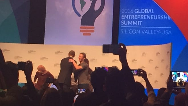 President Obama embraces Facebook CEO Mark Zuckerberg