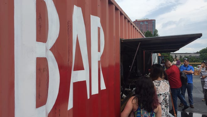 Customers stand in line for beer on opening day of the new Constitution Yards Beer Garden on Wilmington's Riverfront.
