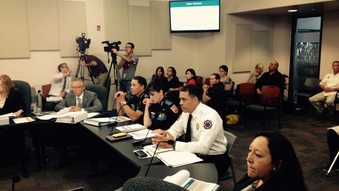 El Paso Fire Chief Samuel Peña, second from right, Assistant Police Chief Michelle Gardner, center, and Police Chief Greg Allen present their budget needs Wednesday at City Hall.