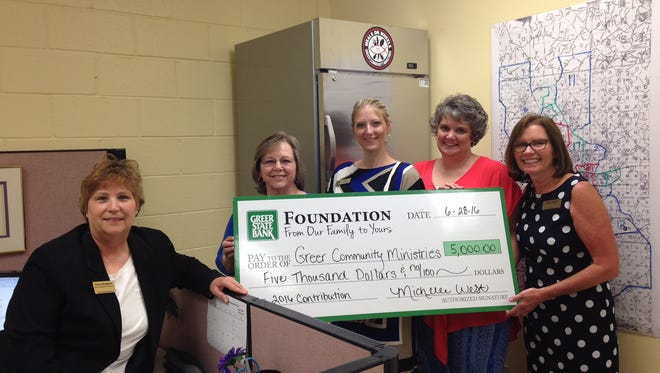From left, Karen Roughton, Greer Community Ministries' Meals on Wheels coordinator, Greer State Bank's Linda Oliver, Mindi Calvert and Shea Boyce, and Cindy Simpler, Greer Community Ministries' executive director, celebrate the gift that has purchased a new milk cooler.