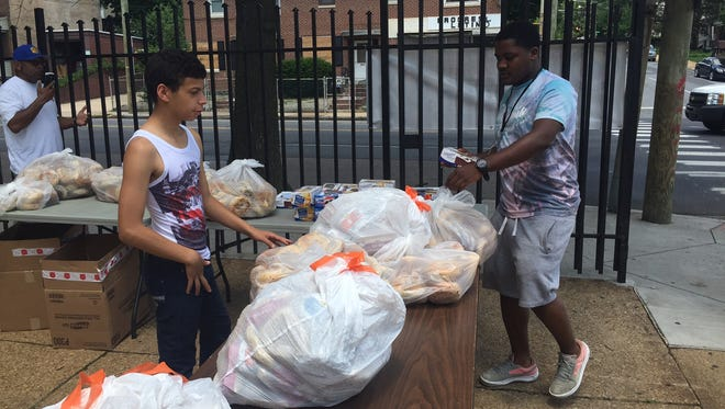 Members of Primera Iglesia De Dios El Peregrino, at Fourth and North Broom streets in Wilmington, have been giving food away every Monday starting at 4 p.m.