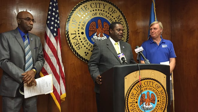 Monroe Mayor Jamie Mayo (at podium) discusses new admission fee proposal for La. Purchase Gardens & Zoo.  He was joined by (L-R) Community Affairs Director John Ross and Zoo Director Joe Clawson in the news conference Monday.