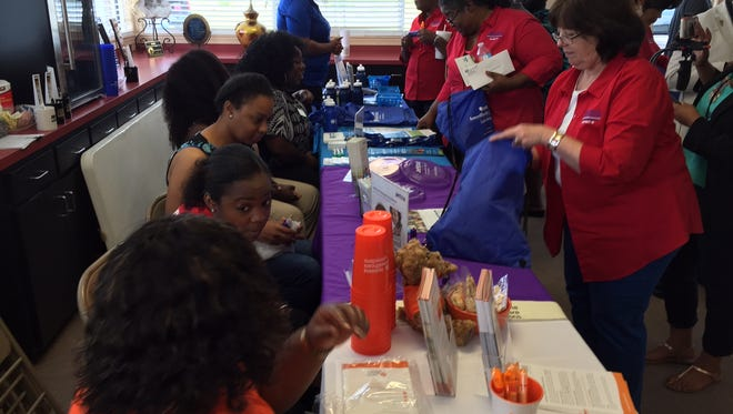 Health care groups and organizations provided information and materials  during a Medicaid Family Enrollment event Friday in Monroe.