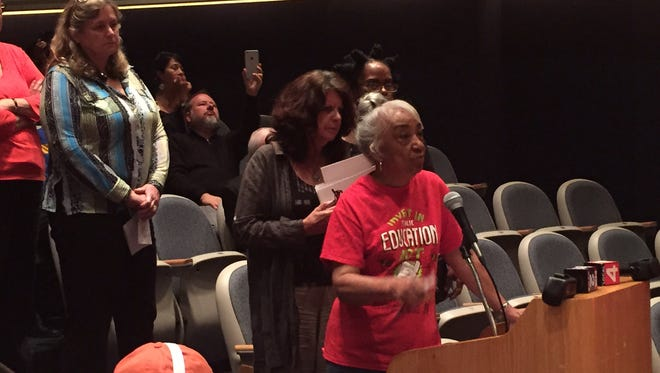 Helen Moore, president of Keep the Vote/No Takeover, speaks out Monday against the state rescue plan for Detroit schools.