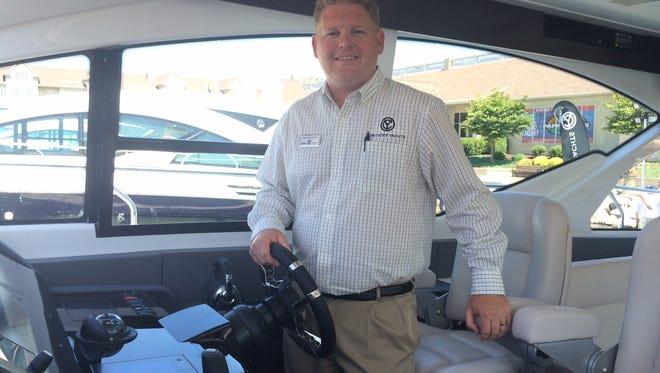 Matt VanGrunsven, director of marketing for KCS International Inc., stands aboard the newly unveiled 60 Flybridge.