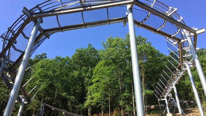 """The Runaway at Branson Mountain Adventure Park, a gravity-powered """"mountain coaster,"""" was under construction in 2016 when this photo was taken."""