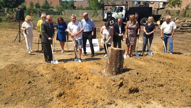 Evesham town officials and others dig into the dirt at a ceremonial groundbreaking at 22 S. Maple Ave. in Marlton.
