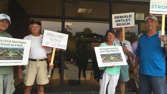 Ortley Beach residents outside the Ocean County Utilities Authority.