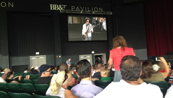 Singer Lenny Kravitz is shown on the big screen at the BB&T Pavilion on Thursday afternoon where he performed at the Camden Rising concert.