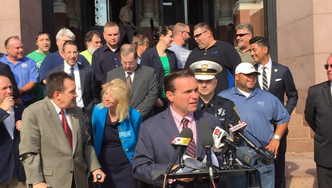 Mayor John Cranley, with union representatives and supporters behind him, made his pitch for pay raises for city workers Thursday outside City Hall.