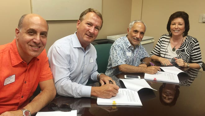 Left to right: Ron Celona, Gary D. Hall, Joe Giarrusso of CVRep, Tami Scott with CURC sign agreement giving CVRep an option to acquire Desert Cinemas in Cathedral City.