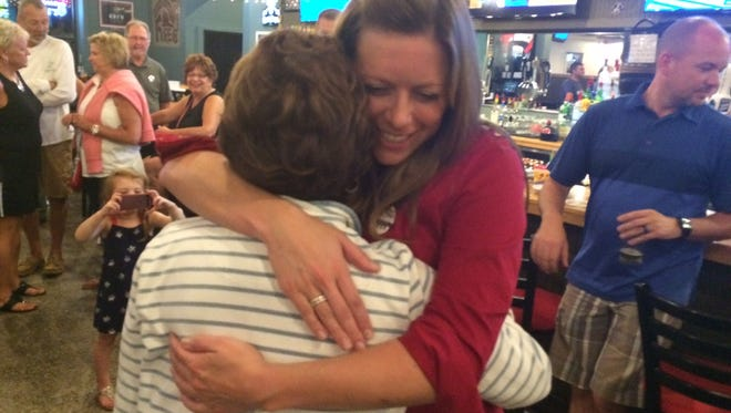 """Colleen Nordin hugs her mother, Pat Nordin, after learning that she won the Republican primary for Door County district attorney on Tuesday night, """"Her father would be so proud,"""" Pat Nordin said."""
