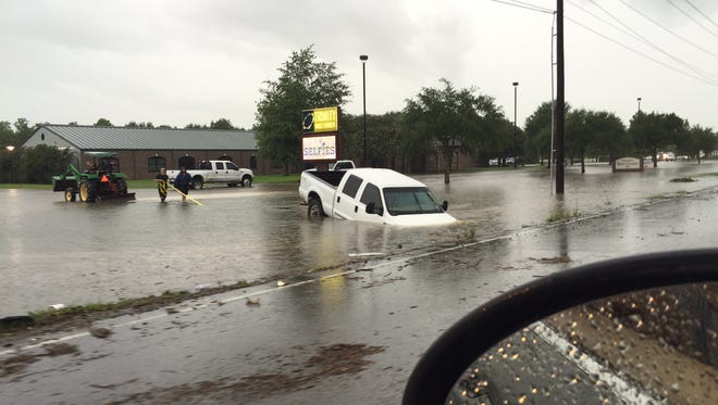 Flooding throughout the Acadiana area has prompted UL to cancel its scrimmage scheduled for Saturday night.