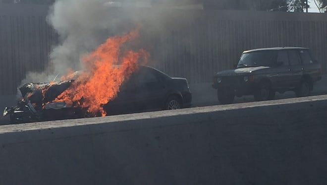 A car burst into flames on Interstate 17 in central Phoenix on Aug. 17, 2016. Southbound lanes near Northern Avenue were affected.