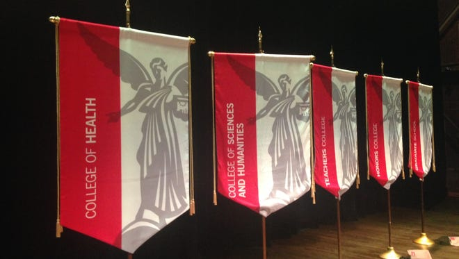 A banner for Ball State's new College of Health stands alongside other college's banners at Emens Auditorium on Friday.