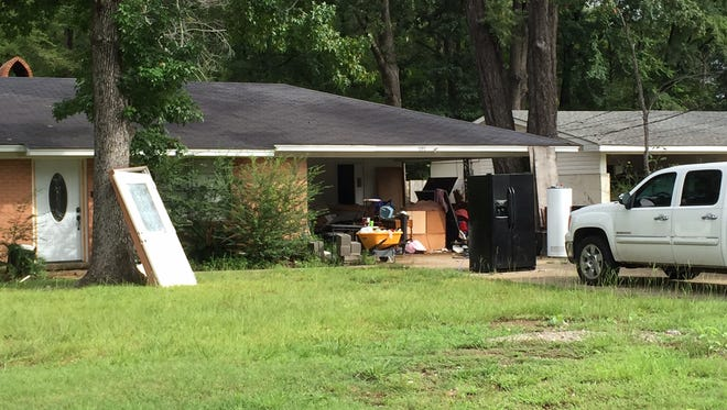 Some area residences are still have items outside of homes as repairs are made after March's flood.