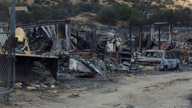 The Blue Cut Fire destroyed about 100 buildings, more than 200 outbuildings and an undetermined amount of vehicles, including those seen here on Friday.