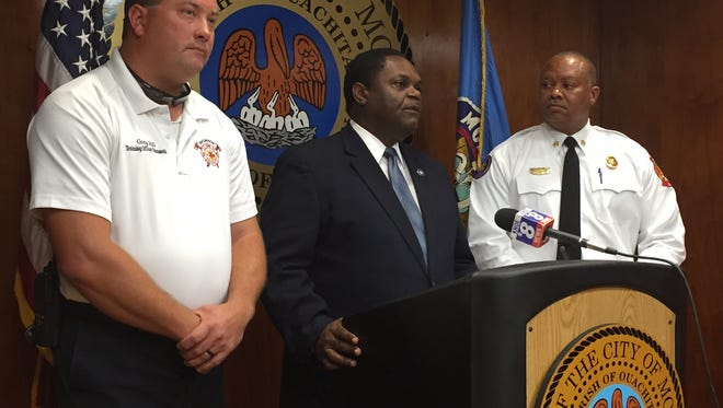 Monroe Mayor Jamie Mayo commended the work of Region 8 Urban Search and Rescue Team for their work in south Louisiana flooding.  He is joined at the podium by Task Force Leader Greg Hill (at left) and Monroe Fire Chief Terry Williams (at right).