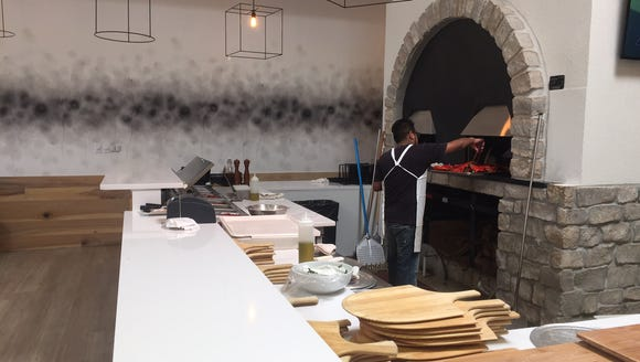 The wood-fire oven is front and center at La Scala