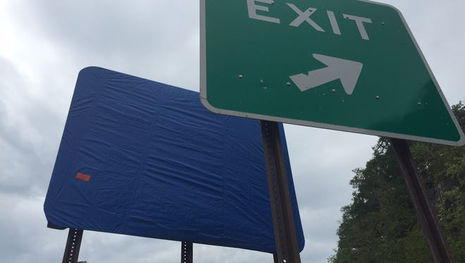 The existing exit sign with the new one behind it at the Baldwin Road exit in Yorktown on Wednesday, August 31, 2016.
