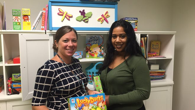Morris Family Justice Center Coordinator Marianne McCrone and Client Service Specialist Natasha DeJesus in the playroom of the center.