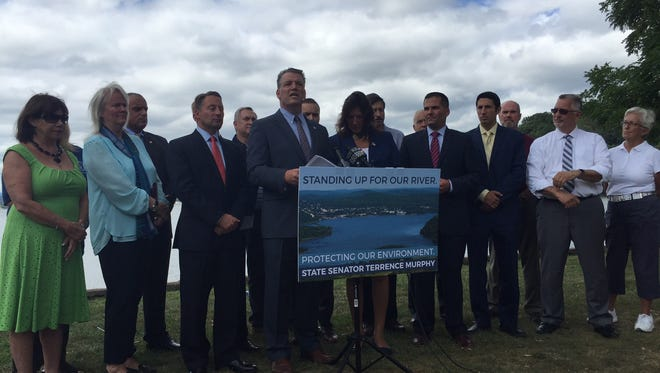Surrounded by fellow state officials, State Sen. Terrence Murphy, R-Yorktown, announces his intention to host public hearings on the Hudson River anchorages on Wednesday, Sept. 7, 2016.