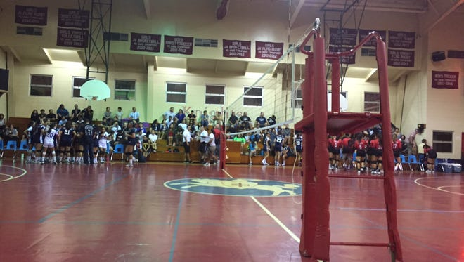 The Academy of Our Lady of Guam Cougars beat the St. John's School Lady Knights in varsity volleyball action on Tuesday.