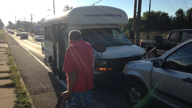 Earnest Beaty, 58, Muncie, stares into the sun after his SUV collided with a day-care bus on Tuesday morning.