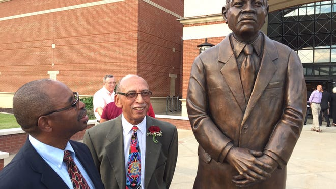 This Sept. 10, 2016 photo shows from left, Princess Anne Town Commission President Garland Hayward and retired UMES art professor Ernest Satchell at the unveiling of a life-size statue of William P. Hytche Sr., the 10th and third longest-serving president at the University of Maryland Eastern Shore. Satchell sculpted the statue that was unveiled at the launch of UMES Founders Week. It stands in front of the Hytche Athletic Center on the UMES campus.