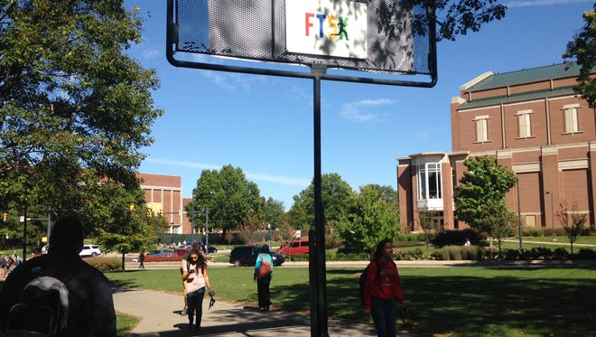 """The """"fly swatter"""" billboard, a landmark at Ball State University, is the subject of a personal injury lawsuit."""