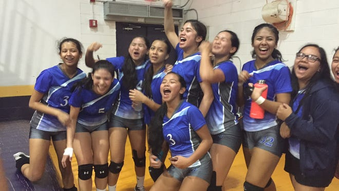 The Notre Dame Royals celebrate their win over the George Washington Geckos in a IIAAG Girls Volleyball League match at the GW gym Friday.