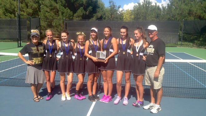 Desert Hills girls varsity tennis poses for a photo after winning four Region 9 finals matches Saturday, October 1, 2016.