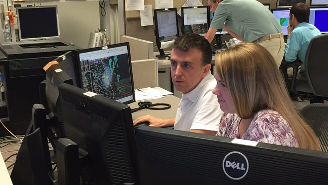 Will Ulrich and Jessie Smith, meteorologists from the National Weather Service in Melbourne, analyze Hurricane Matthew at the National Weather Service forecast office in Melbourne on Tuesday afternoon.