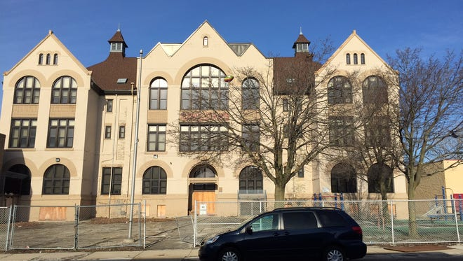 The former Garfield Avenue Elementary School would be redeveloped into apartments under a new proposal.