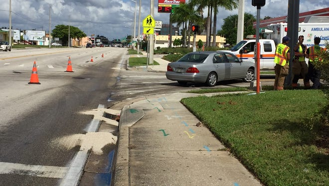 A car slid on fuel oil spilled along Clecvland Avenue near Edison Avenue on Tuesday and crashed into a Lee County ambulance. There were no injuries.