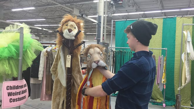 Shakespeare Theatre of New Jersey master electrician Tyler Barrett arranges lion costumes at the theater's annual Costume & Prop sale in Florham Park on Oct. 22, 2016.
