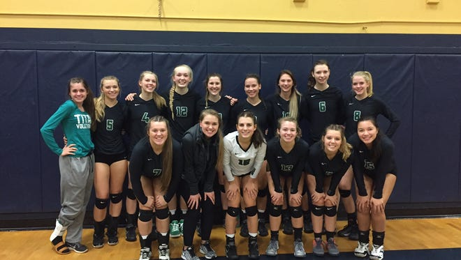 West Salem's volleyball team poses for a photo after winning the Greater Valley Conference championship on Thursday, Oct. 20, 2016.