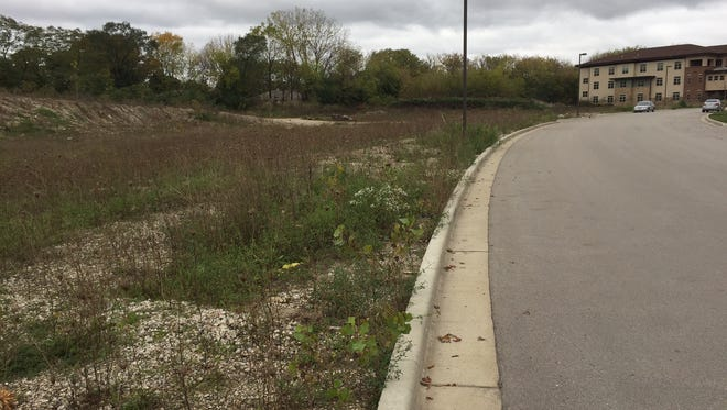A four-story apartment building for seniors is planned for a vacant Wauwatosa site on Rivers Bend, just south of Oak Park Place (background).