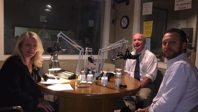 WMTR radio host Julie Briggs conducts a broadcast debate on Sunday, Oct. 30, between District 11 Congressman Rodney Frelinghuysen, center, and Democratic challenger Joe Wenzel.