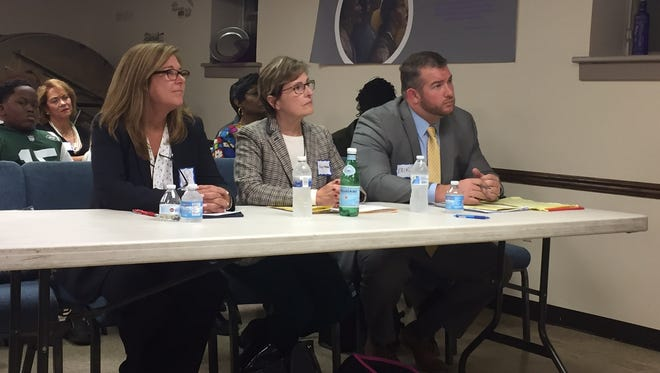 From left, Cindy Burnham, Kathy Horgan and Erik Yngstrom before a debate at Pilgrim Baptist Church.