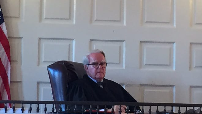 Superior Court Judge Paul Armstrong, sitting in Morristown, listens to testimony in case of woman who wants to starve herself over opposition by the state Department of Human Services.